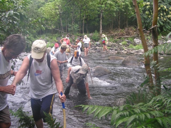 Kona Hiking Club crossing Waipio Valley River